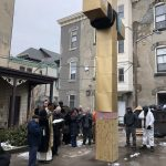 Fr. Joseph prays a blessing over the new cross at St. Vincent's